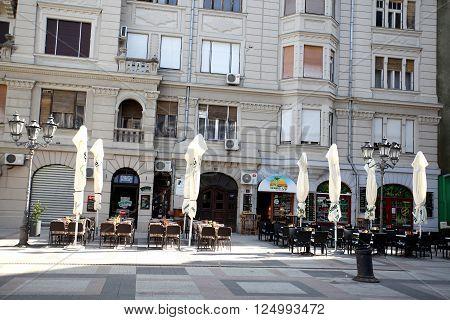 Novi Sad, Serbia - april 3. 2016 -Katolicka Porta in Novi Sad in the centre of Novi Sad - back yard. Streets with old houses of the old town wtih many caffe shops.