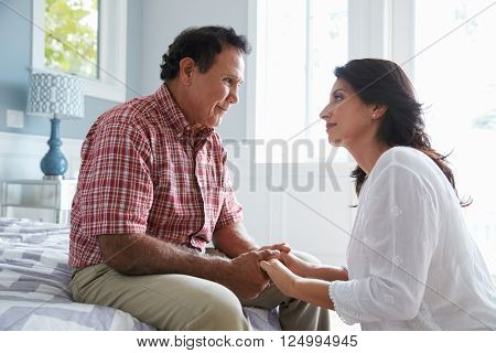 Adult Daughter Comforting Father Suffering With Dementia poster