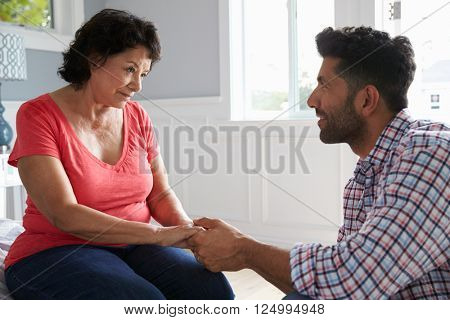 Adult Son Comforting Mother Suffering With Dementia poster
