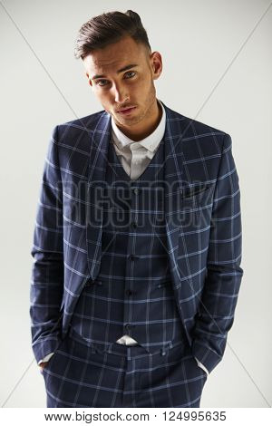 Elevated view of young man wearing suit