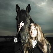 Fashionable portrait of a beautiful young woman and horse poster