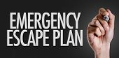 Hand writing the text: Emergency Escape Plan poster