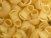 thick' hollow and short macaroni. close-up. cooking ingredients poster