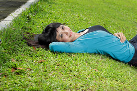 sweet young woman lying down