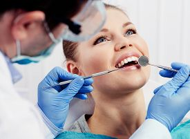 Caries protection. Tooth decay treatment. Female patient at dentist office curing teeth.