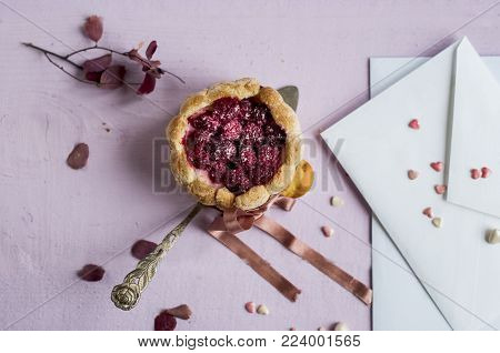 French charlotte with raspberry decorated pink ribbon, flat  lay