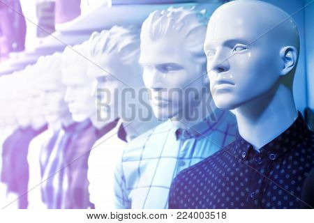 Dummy in the men's clothing store in blue and purple color