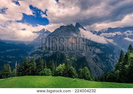 View from Murren on the Bernese Alps on a cloudy day in summer. Murren - Bernese Oberland - Switzerland
