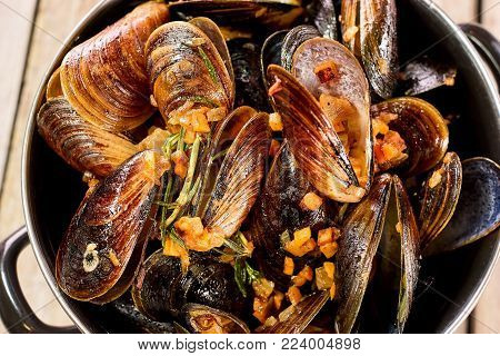 Heap of opened mussels. Opened cooked mussels closeup.