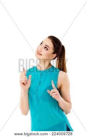 Woman showing something up above her with her finger isolated on white background