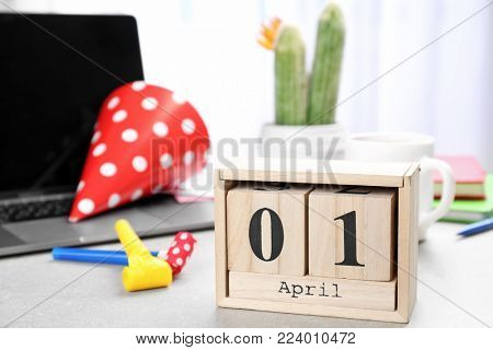 Block calendar on office table. April fool's day celebration