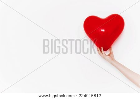 Red Heart In Hand, Isolated On White. Happy Valentine's Day Concept. Healthcare, Medicine And Blood