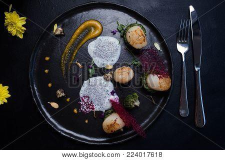 molecular gourmet cuisine unusual dark background concept. exquisite delicacies. specific food