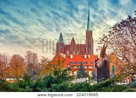 Wroclaw Poland Tumski island view at cathedral saint John the Baptist autumn landscape with dramatic sky.