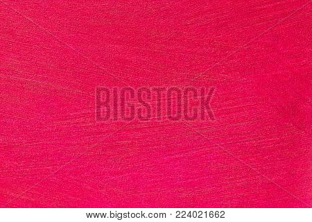 Structures on red paper as background. Shot in Studio.