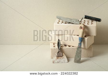 Plaster trowel tools with bricks.Building and renovation concept. Free copy space.