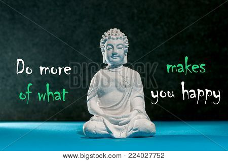 Do more of what makes you happy Background with white statuette of Buddha. Yoga and meditation concept.