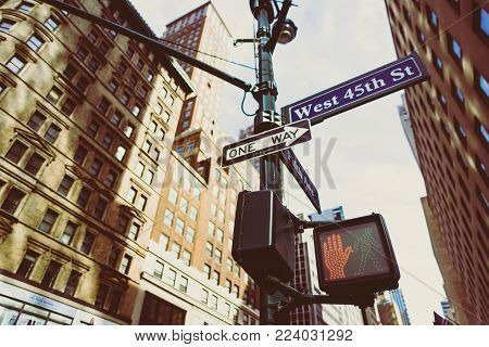 New York, Ny - June 8th, 2014: Street Sign And Street Light In Manhattan