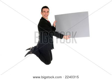 Businessman Jumping With Blank Placard