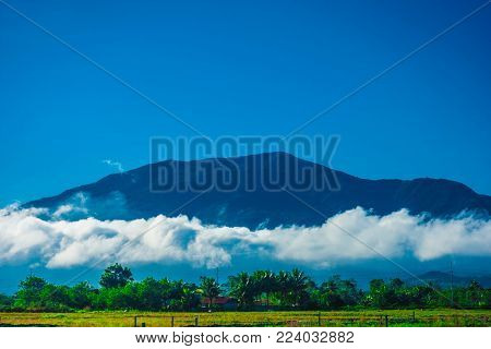 Scenic landscapes of low clouds around the main peak located in rural Solano, Nueva Vizcaya, Philippines
