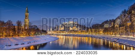 Panoramic view of the historic city of Salzburg with Salzach river in winter during blue hour, Salzburger Land, Austria