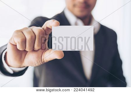business man is stressed from work , laptop and document paperwork on office desk - business concept
