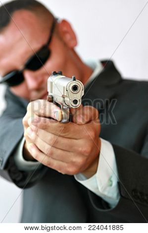 young men with chromed pistol, security concept series