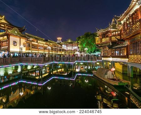 Shanghai, China - Nov 5, 2017: Yuyuan Bazaar in Shanghai at night. It is a marketplace with traditional architecture. It is next to Yuyuan Garden and is a popular tourist attractions in Shanghai.