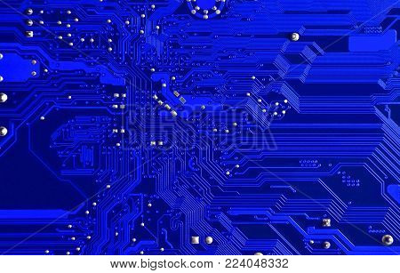 Close up of old printed blue computer circuit board