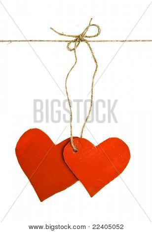 two paper hearts connected with a rope