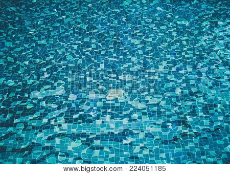 Background of rippled water in swimming pool, Top View.