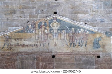 LUCCA, ITALY - JUNE 03: Fresco featuring the Martyrdom of Saints Lawrence, Vincent and Stephen in Basilica of Saint Frediano, Lucca, Tuscany, Italy on June 03, 2017.