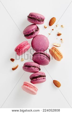 French macarons with almonds. Sweet french macaroons on white background.