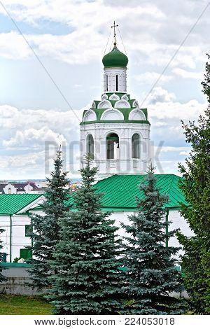 KAZAN, RUSSIA - JULY 26, 2014: Church of St. John the Baptist and the Tower of the Savior against the blue sky. Kazan Kremlin, Tatarstan Republic.