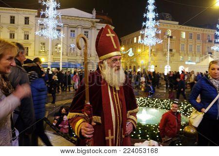 ZAGREB, CROATIA - NOVEMBER 26, 2016: Advent in Zagreb, Croatia. St. Nicholas giving gifts to children in Zagreb, Croatia on November 26, 2016.