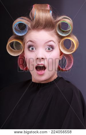 Funny Surprised Blond Girl Hair Curlers Rollers By Hairdresser In Salon
