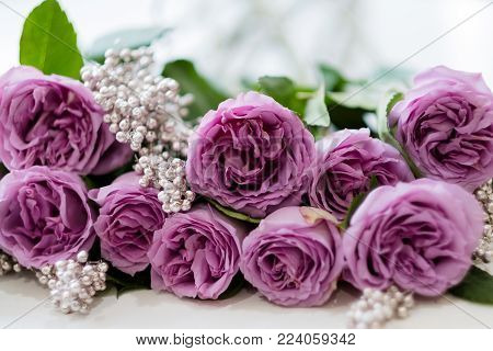 Pink roses and silver decor. Pretty anniversary flower arrangement gift. Simple composition to surprise your spouse
