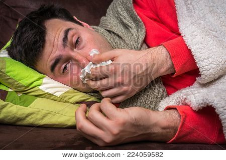 Sick Man Having Flu And Blowing Her Runny Nose