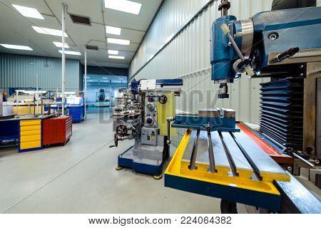 Metalworking shop, vertical milling machine. Movable desktop close-up.