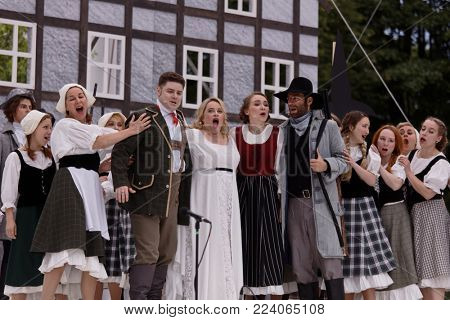 ST. PETERSBURG, RUSSIA - JULY 19, 2017: Actors perform the opera The Marksman of C. M. von Weber outdoors during the festival All Together Opera. It was third of 4 performances
