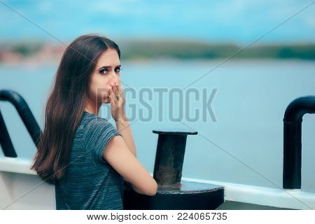 Sea sick woman suffering motion sickness while on boat
