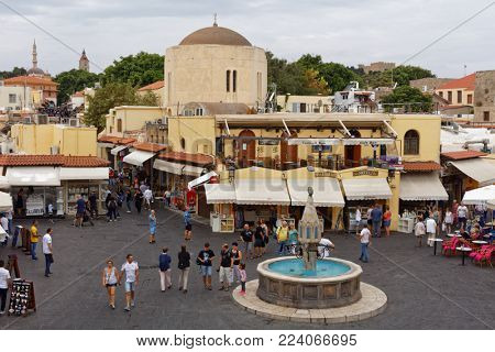 RHODES, GREECE - OCTOBER 7, 2017: People walking and resting on Hippocrates Square. Hippocrates Square is famous for its nightlife