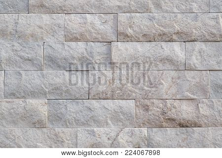 White quartz marble brick background photograph. Luxury white quartz maple type bricks, with natural rough face. Authentic photograph shot outdoors with natural light.