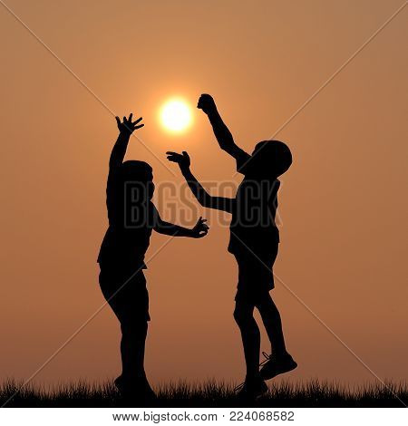 Black children silhouettes playing with the sun