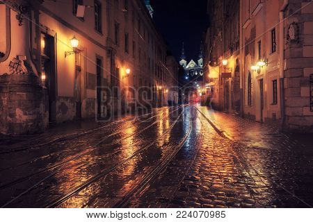 Old European city at night. Dark street city view