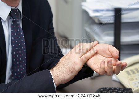 Hand Pain. Office worker man Hands Hurt. Close-up Of men's Hands With Painful Feeling In Joint. Hand Injury And Health Issues Concept.
