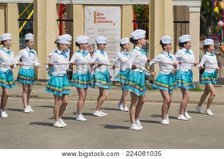 Lviv, Ukraine - May 07, 2017: Band majorettes perform various dancing skills on city park  the annual brass band exhibition in honor of the city day Lviv, Ukraine .