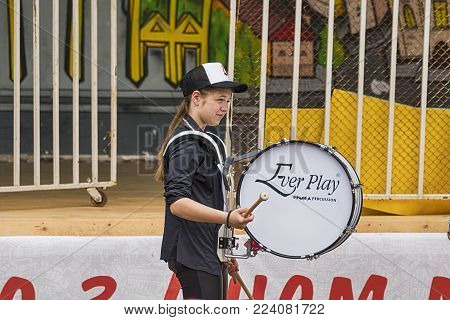 Lviv, Ukraine - May 07, 2017: Unknown drummer girl during a rehearsal in the city park before the celebrations of the city's day  of Lviv., Ukraine.