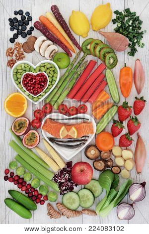 Large super food selection for good health with fresh fish, nuts, fruit and vegetables. High in omega 3 fatty acids, antioxidants, anthocyanins, minerals, vitamins and dietary fibre. Top view.