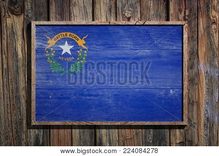 3d Rendering Of A Nevada State Usa Flag On A Wooden Frame And A Wood Wall